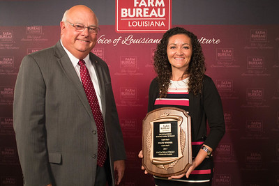 Natachia Stelly of Vermilion Parish wins the 2017 Young Farmers and Ranchers Outstanding Young Farm Woman contest. The award was presented by Louisiana Farm Bureau President Ronnie Anderson.