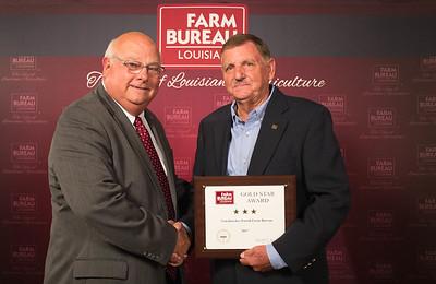 Natchitoches Farm Bureau Parish member Jack Pace accepts the Three Gold Star Award from Louisiana Farm Bureau President Ronnie Anderson.