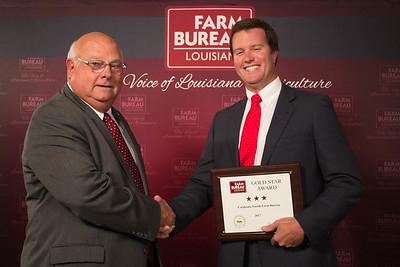 Catahoula Farm Bureau Parish President Burch Pierce accepts the Three Gold Star Award from Louisiana Farm Bureau President Ronnie Anderson.