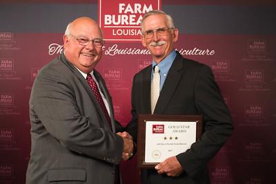 Jeff Davis Farm Bureau Parish President Kent Brown accepts the Three Gold Star Award from Louisiana Farm Bureau President Ronnie Anderson.