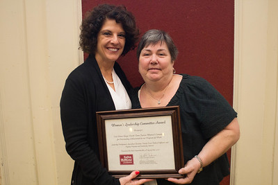 East Baton Rouge Parish Farm Bureau was recognized for outstanding achievement in the Women's Leadership Committee program by Louisiana Farm Bureau Women's Leadership Committee State Chair Denise Cannatella. Accepting the certificate is East Baton Rouge Parish Farm Bureau Women's Leadership Committee Chair Joy Womack.
