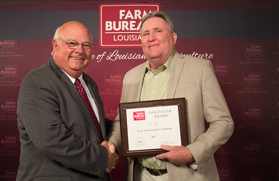 West St. James Farm Bureau Parish President Greg Gravois accepts the Two Gold Star Award from Louisiana Farm Bureau President Ronnie Anderson.