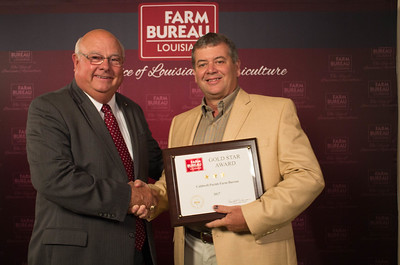 Caldwell Farm Bureau Parish President Randy Rentz accepts the Three Gold Star Award from Louisiana Farm Bureau President Ronnie Anderson.