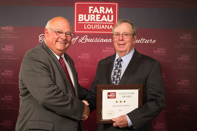 Allen Farm Bureau Parish President Thomas Mayes accepts the Three Gold Star Award from Louisiana Farm Bureau President Ronnie Anderson.
