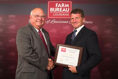 DeSoto Farm Bureau Parish President Joey Register accepts the Four Gold Star Award from Louisiana Farm Bureau President Ronnie Anderson.