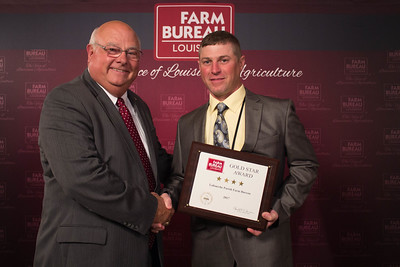Lafourche Farm Bureau Parish President Jason Richard accepts the Four Gold Star Award from Louisiana Farm Bureau President Ronnie Anderson.
