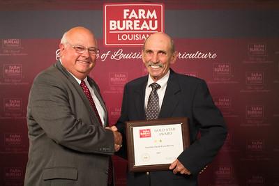 Ouchita Farm Bureau Parish President Larry Rutledge accepts the Two Gold Star Award from Louisiana Farm Bureau President Ronnie Anderson.