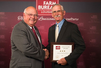 Jeff Davis Farm Bureau Parish President Kent Brown accepts the Three Gold Star Award from Louisiana Farm Bureau President Ronnie Anderson.