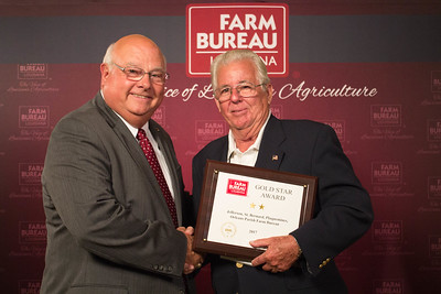Jefferson, St. Bernard, Plaquemines, Orleans Farm Bureau Parish member Dan Coulon accepts the Two Gold Star Award from Louisiana Farm Bureau President Ronnie Anderson.