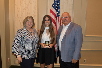 Bailey Nelson of Calcasieu Parish is awarded for participating the 2017 Talk Meet. Contest Chair Lisa Register and Louisiana Farm Bureau President Ronnie Anderson present the award.