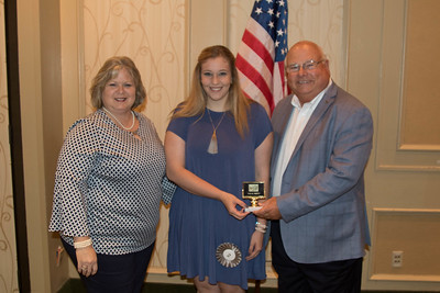 Abby Gail Miller of Acadia is awarded for participating the 2017 Talk Meet. Contest Chair Lisa Register and Louisiana Farm Bureau President Ronnie Anderson present the award.