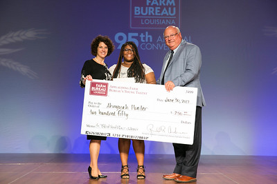 Ahnyyah Hunter of Lafourche Parish was named the first place winner of the Senior Talent Contest. Presenting her award are Louisiana Farm Bureau Women's Leadership Committee State Chair Denise Cannatella and Louisiana Farm Bureau President Ronnie Anderson.