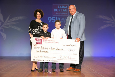 Ashton Aucoin and Ivan Aucoin of Calcasieu Parish were named the third place winners of the Junior Talent Contest. Presenting their award are Louisiana Farm Bureau Women's Leadership Committee State Chair Denise Cannatella and Louisiana Farm Bureau President Ronnie Anderson.