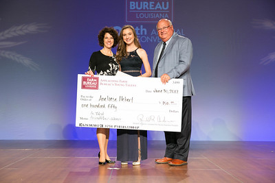 Aneliese Hebert of Vermilion Parish was named the second place winner of the Senior Talent Contest. Presenting her award are Louisiana Farm Bureau Women's Leadership Committee State Chair Denise Cannatella and Louisiana Farm Bureau President Ronnie Anderson.