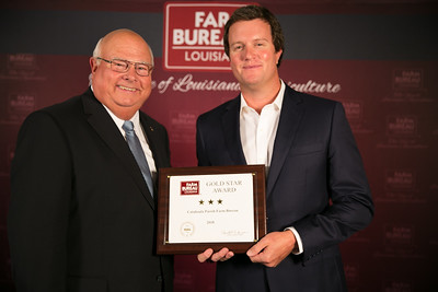 Catahoula Farm Bureau Parish President Burch Pierce accepts the three Gold Star Award from Louisiana Farm Bureau President Ronnie Anderson. The award was presented at the 96th Annual Convention of the Louisiana Farm Bureau Federation in New Orleans.