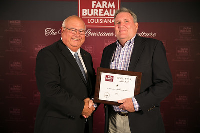 West St. James Farm Bureau Parish President Greg Gravois accepts the one Gold Star Award from Louisiana Farm Bureau President Ronnie Anderson. The award was presented at the 96th Annual Convention of the Louisiana Farm Bureau Federation in New Orleans.