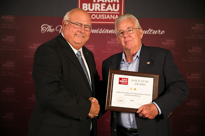 Jefferson, St. Bernard, Plaquemines and Orleans Farm Bureau Parish member Dan Coulon accepts the two Gold Star Award from Louisiana Farm Bureau President Ronnie Anderson. The award was presented at the 96th Annual Convention of the Louisiana Farm Bureau Federation in New Orleans.