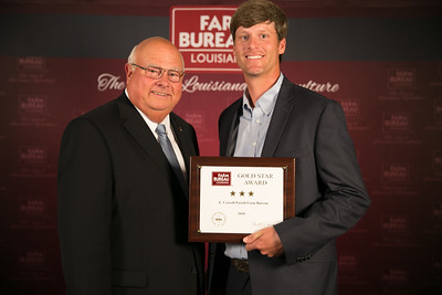 East Carroll Farm Bureau Parish President Phillip Tomlinson accepts the three Gold Star Award from Louisiana Farm Bureau President Ronnie Anderson. The award was presented at the 96th Annual Convention of the Louisiana Farm Bureau Federation in New Orleans.