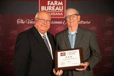 Livingston Farm Bureau Parish President Charles Kemp accepts the three Gold Star Award from Louisiana Farm Bureau President Ronnie Anderson. The award was presented at the 96th Annual Convention of the Louisiana Farm Bureau Federation in New Orleans.