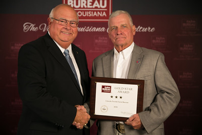 Lincoln Farm Bureau Parish President Track Kavanaugh accepts the three Gold Star Award from Louisiana Farm Bureau President Ronnie Anderson. The award was presented at the 96th Annual Convention of the Louisiana Farm Bureau Federation in New Orleans.
