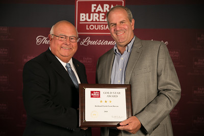 Richland Farm Bureau Parish President Hunter Fife accepts the three Gold Star Award from Louisiana Farm Bureau President Ronnie Anderson. The award was presented at the 96th Annual Convention of the Louisiana Farm Bureau Federation in New Orleans.