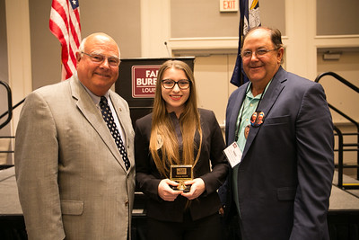 Sadie Wright of St. Martin Parish receives her award for participating in the 2018 Talk Meet from Louisiana Farm Bureau President Ronnie Anderson. Pictured with them is St. Martin Farm Bureau Parish President Mike Melancon.