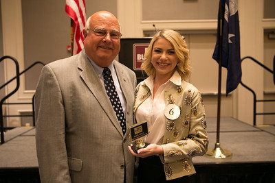 Alizabeth Adam Guillot of Richland Parish receives her award for participating in the 2018 Talk Meet from Louisiana Farm Bureau President Ronnie Anderson.