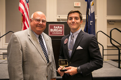 Jacob Martin of Lafayette Parish receives his award for participating in the 2018 Talk Meet from Louisiana Farm Bureau President Ronnie Anderson.