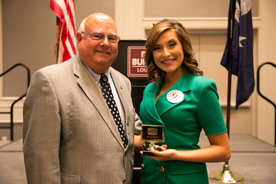 Brooke Rian Comeaux of Acadia Parish receives her award for participating in the 2018 Talk Meet from Louisiana Farm Bureau President Ronnie Anderson.