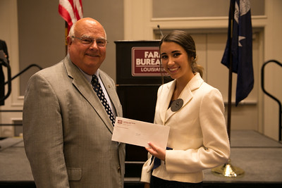 Bailey Ann Nelson of Calcasieu Parish wins third place in the 2018 Talk Meet at the 96th Louisiana Farm Bureau Convention in New Orleans. Presenting her award is Louisiana Farm Bureau President Ronnie Anderson.