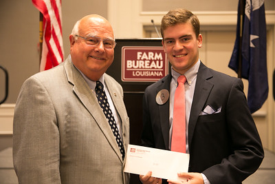 Wesley Adolph of Assumption Parish wins second place in the 2018 Talk Meet at the 96th Louisiana Farm Bureau Convention in New Orleans. Presenting hisr award is Louisiana Farm Bureau President Ronnie Anderson.