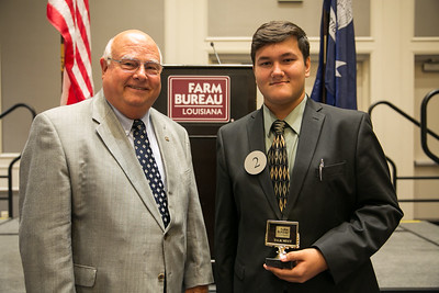Liam Gordon of Rapides Parish receives his award for participating in the 2018 Talk Meet from Louisiana Farm Bureau President Ronnie Anderson