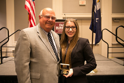 Sadie Wright of St. Martin Parish receives her award for participating in the 2018 Talk Meet from Louisiana Farm Bureau President Ronnie Anderson.