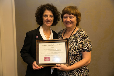 Tangipahoa Farm Bureau Women's Leadership Committee Parish President Rosemary Ridgedell receives the certificate for Outstanding Achievement at the 96th Louisiana Farm Bureau Women's Leadership Committee Business Session.