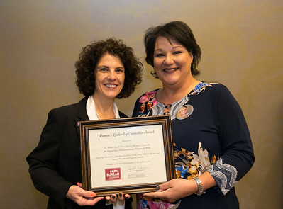 """St. Martin Farm Bureau Women's Leadership Committee Parish President Isabelle """"Kizzy"""" Theriot receives the certificate for Outstanding Achievement at the 96th Louisiana Farm Bureau Women's Leadership Committee Business Session."""