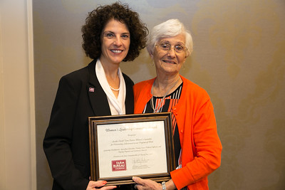 Acadia Farm Bureau Women's Leadership Committee Parish member Eldine Richland receives the certificate for Outstanding Achievement for Acadia at the 96th Louisiana Farm Bureau Women's Leadership Committee Business Session.