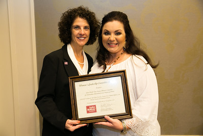 Grant Farm Bureau Women's Leadership Committee Parish President Danielle Yerby receives the certificate for Outstanding Achievement at the 96th Louisiana Farm Bureau Women's Leadership Committee Business Session.