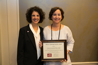 Assumption Farm Bureau Women's Leadership Committee Parish President Sandy Mallingly receives the certificate for Outstanding Achievement at the 96th Louisiana Farm Bureau Women's Leadership Committee Business Session.