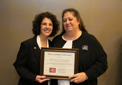 Louisiana Farm Bureau Women's Leadership Committee District IV chair Shauna Durr receives the certificate for Outstanding Achievement for Natchitoches Parish at the 96th Louisiana Farm Bureau Women's Leadership Committee Business Session.