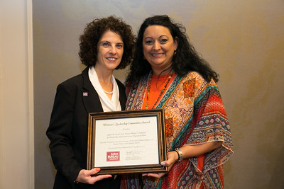 Lafourche Farm Bureau Women's Leadership Committee member Nicole Foret receives the certificate for Outstanding Achievement for Lafourche Parish at the 96th Louisiana Farm Bureau Women's Leadership Committee Business Session.