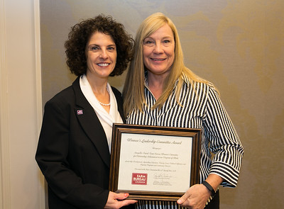 Avoyelles Farm Bureau Women's Leadership Committee Parish President Janis Lamartiniere receives the certificate for Outstanding Achievement at the 96th Louisiana Farm Bureau Women's Leadership Committee Business Session.