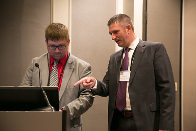 Louisiana Farm Bureau Area I Field Services Director Chris long, left and Area II Field Services Director Vinson Whatley assist with setting up presentations for the 2018 Young Farmers and Ranchers Excellence in Agriculture final presentations.