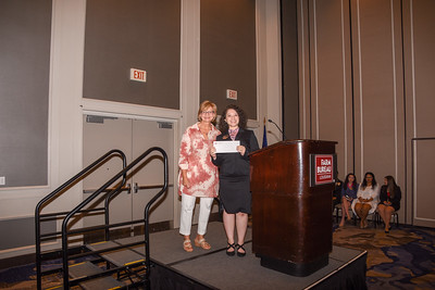 Lilly Martinez of Point Coupee Parish accepts her award for third place presented by Chair Karla Wiggers.