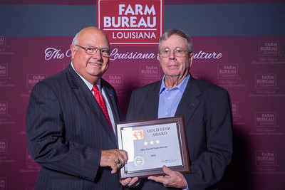 Allen Farm Bureau Parish President Thomas Mayes accepts the three Gold Stars Award from Louisiana Farm Bureau President Ronnie Anderson. The Award was presented at the 97th Annual Convention of the Louisiana Farm Bureau Federation in New Orleans.