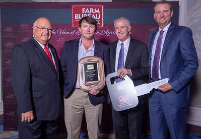 Kody Beavers of Franklin Parish receives his award for Discussion Meet State Winner from Louisiana Farm Bureau President Ronnie Anderson and John Deere representative Randy Johns, and Will Waldrop. The Award was presented at the 97th Annual Convention of the Louisiana Farm Bureau Federation in New Orleans.