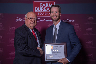 East Carroll Farm Bureau Parish President Phillip Tomlinson accepts the three Gold Stars Award from Louisiana Farm Bureau President Ronnie Anderson. The Award was presented at the 97th Annual Convention of the Louisiana Farm Bureau Federation in New Orleans.