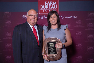 Megan Cook of Sabine Parish receives her award for Outstanding Young Farmer women State Winner from Louisiana Farm Bureau President Ronnie Anderson. The Award was presented at the 97th Annual Convention of the Louisiana Farm Bureau Federation in New Orleans.