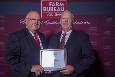Ouachita Farm Bureau Parish President Butch Oaks accepts the two Gold Stars Award from Louisiana Farm Bureau President Ronnie Anderson. The Award was presented at the 97th Annual Convention of the Louisiana Farm Bureau Federation in New Orleans.