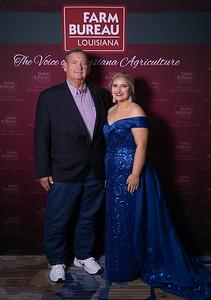 Queen's Contest Contestant Isabel Kate LaFosse of Acadia Parish with Acadia Farm Bureau Parish President Mike Habetz.