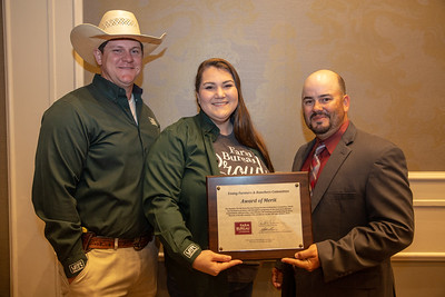 Robert and Rachel Duncan of Rapides Parish receives the 2019 Award of Merit from Louisiana Farm Bureau Young Farmers and Ranchers state chair Matt Gravois, on behalf of the Rapides Parish Farm Bureau Young Farmers and Ranchers committee.